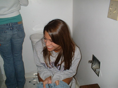 My girlfriend on the toilet
